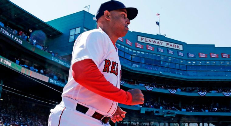Alex Cora - Boston Red Sox manager Alex Cora runs onto the field as he is introduced during ceremonies prior to the home opener against the Tampa Bay Rays at Fenway Park in Boston on Thursday, April 5, 2018. (AP Photo/Charles Krupa)